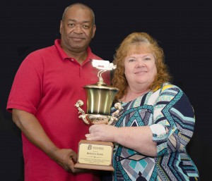 Boyd Transportation professional driver, Johnnie Cobb, and driver manager Ruth Brummitt proudly hold a trophy the company awarded to Cobb for achieving 3 million consecutive safe miles.