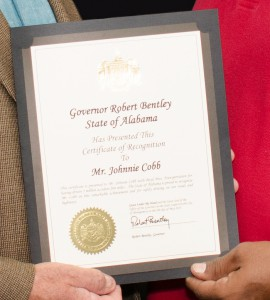 Alabama Gov. Robert Bentley honors Boyd Transportation professional driver Johnnie Cobb for driving 3 million consecutive safe miles.