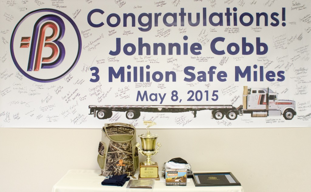 A congratulatory poster signed by the Boyd Transportation staff honors professional driver Johnnie Cobb for achieving 3 million consecutive safe miles.