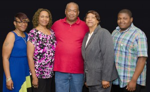 Boyd Transportation professional driver Johnnie Cobb (at center) enjoys the company's accolades for achieving 3 million consecutive safe miles while driving for Boyd. Johnnie's family joined him in the celebration at the company's headquarters. From left to right are: daughter, Artisha Richmond; wife, Annette Cobb; mother-in-law Princella Echols and grandson, Jarnard Richmond.
