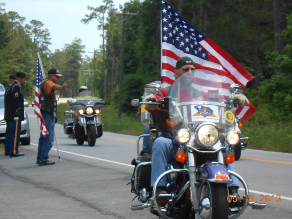 Bob honoring a fallen veteran by leading his funeral procession.
