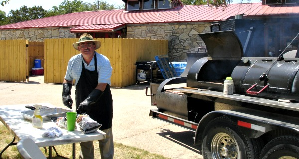 During the cookout, Jim McKenzie and Hugo Bonacci cooked both lunch and dinner for about 250 guests and children.