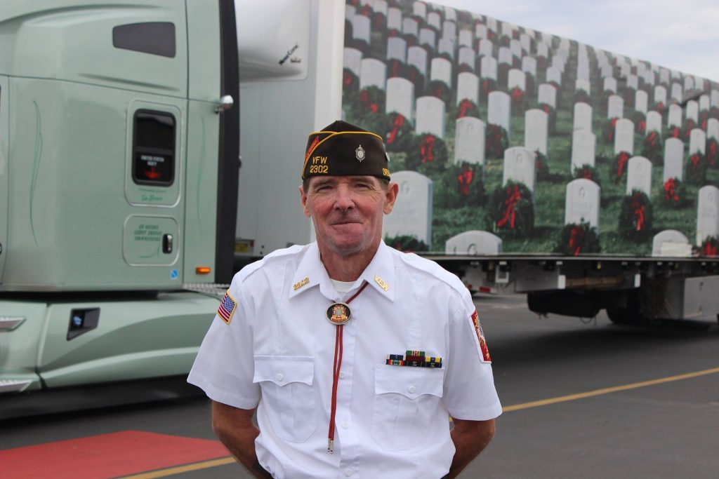 Tim (Central Oregon Truck Company) stands by his truck while delivering wreaths.