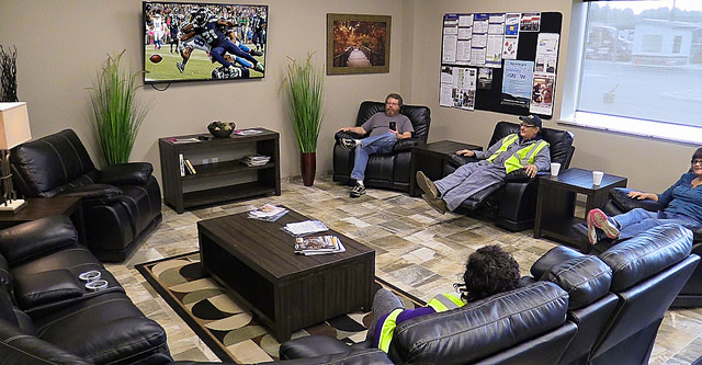 Smokey Point Distributing's new home terminal in Arlington, Washington, offers drivers coming off the road a large entertainment room filled with leather recliners and sectionals for relaxing and watching the big-screen TV.