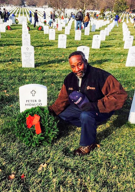 Charlie Walker, a Boyd Bros. driver with 3 million safe miles, lays a Christmas wreath at the grave of a veteran. Walker is one of several drivers from Daseke companies who volunteered to deliver wreaths to veteran cemeteries across the United States.
