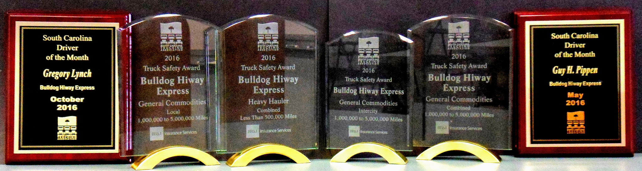 Bulldog Hiway Express displays its top safety awards in four categories and two driver of the month awards from the South Carolina Trucking Association (SCTA).
