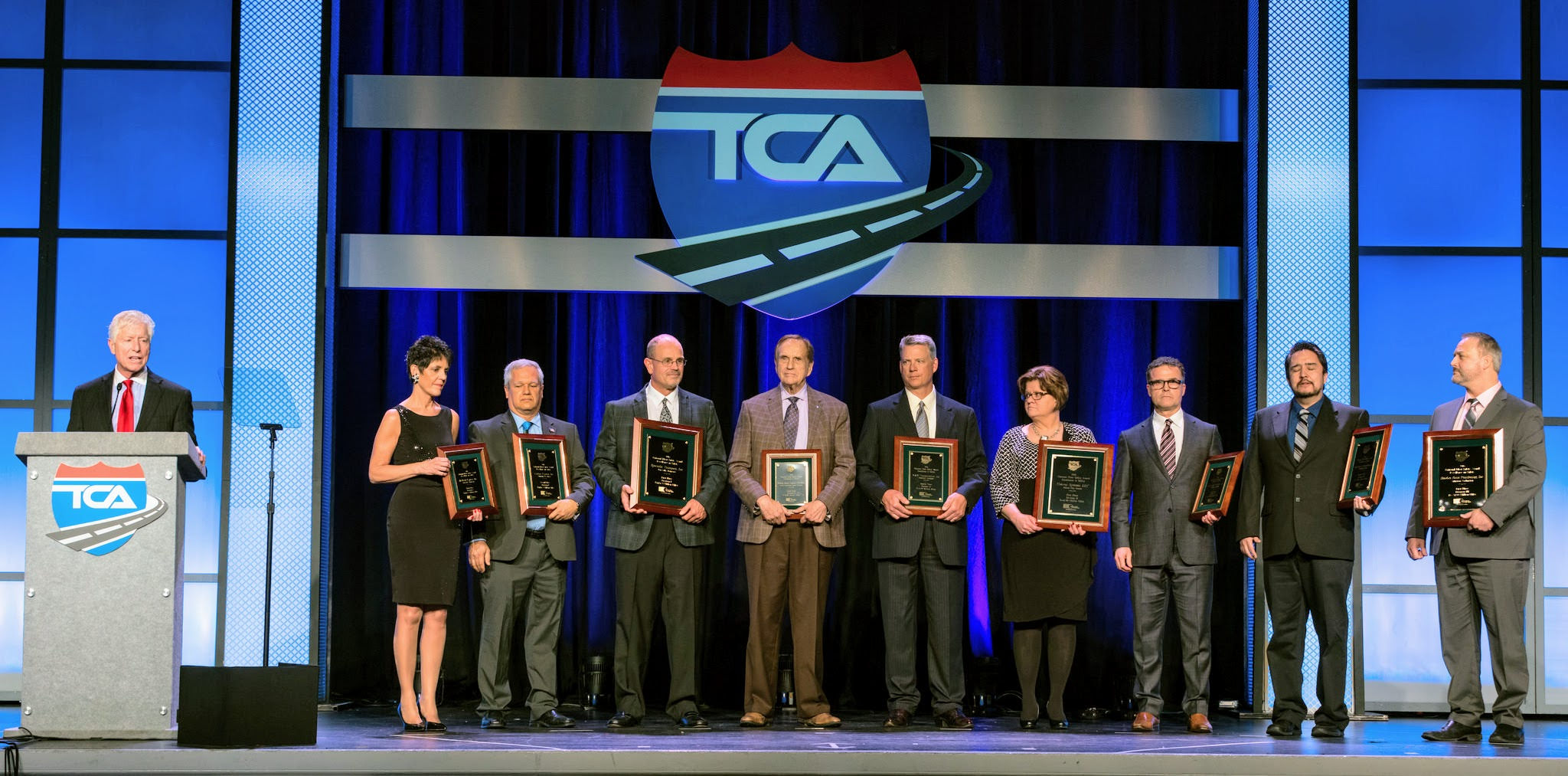 Patrick Kuehl, executive vice president of Great West Casualty Company (at podium), acknowledges several fleets honored with top safety awards for their outstanding safety records in 2016 at the Truckload Carriers Association's Annual Convention in Nashville, Tennessee.
