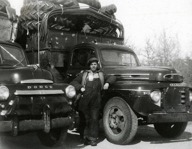 "Big Freight Systems founder Seaton ""Red"" Coleman stands next to a 1948 Dodge and a 1949 Mercury operated by South East Transfer, the company he and his father bought in 1948. South East Transfer adopted its new name, Big Freight Systems, in 1996."